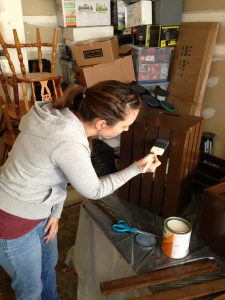 Chris captured the picture of me applying the sealant to the crate!