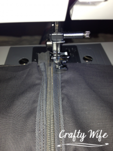 Sewing the lining onto the invisible zipper.