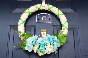 Brighten up your front door with a simple Spring Garden Wreath to celebrate the warmer weather that this season brings!
