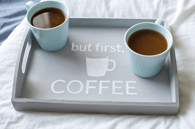 Make mornings more fun with an easy-to-make tray for your daily cup of coffee. Using chalk paint, a silhouette stencil, and an unfinished wooden tray from any craft store!