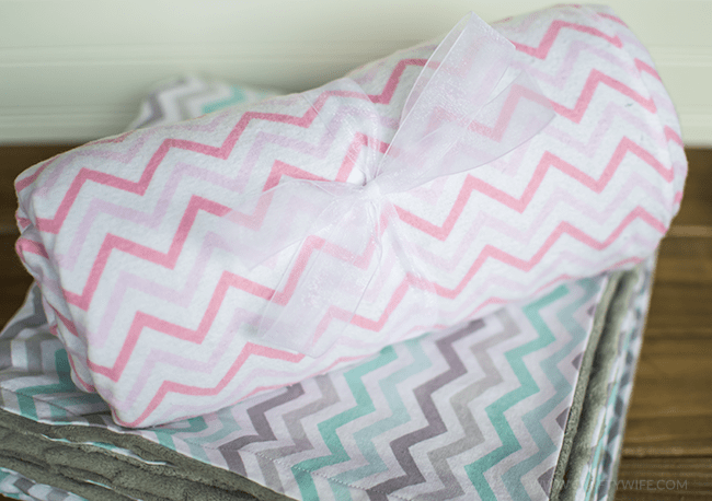 Learn how to sew with this easy 30 minute baby blanket tutorial, perfect for a beginner! Mama and baby will love the softness of the fabric and the thoughtfullness of this homemade gift. #sewing #crafts #homemade #baby