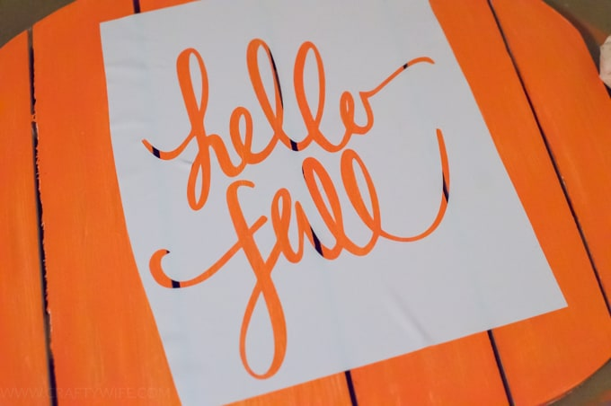 Learn how to easily make a stencil with your Silhouette cutting machine and use it to decorate a Hello Fall wreath to hang on your front door!