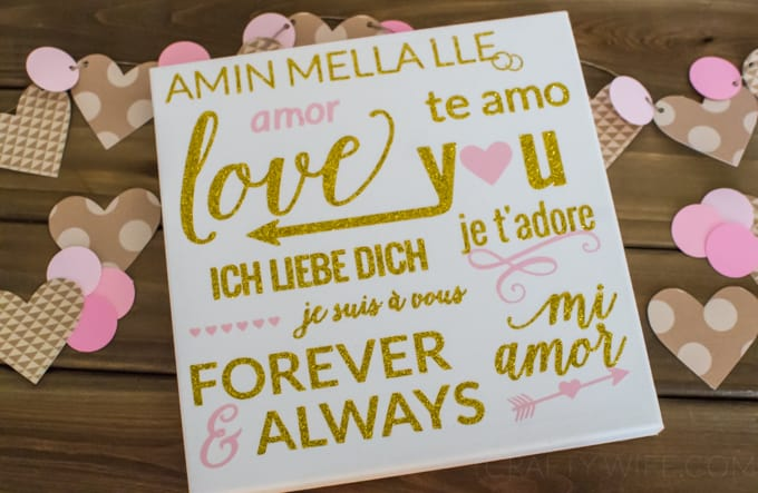 Use heat transfer vinyl to make a silhouette canvas art project for Valentine's Day! It's subtle enough to display all year round but still perfectly lovey.