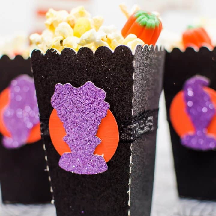 Halloween Popcorn Bags - Hocus Pocus is my favorite Halloween movie and I watch it multiple times every year. These DIY paper popcorn bags cut with my Silhouette machine are the perfect movie-watching treat bag!