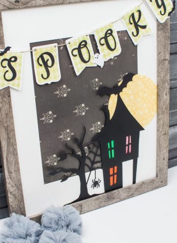 Spooky Halloween Frame - I hate the scary aspect of Halloween so I typically don't decorate for the holiday. But I found the perfect non-scary Silhouette file and paired it with my paper banner to create a fun Halloween decoration that's more cute than spooky!