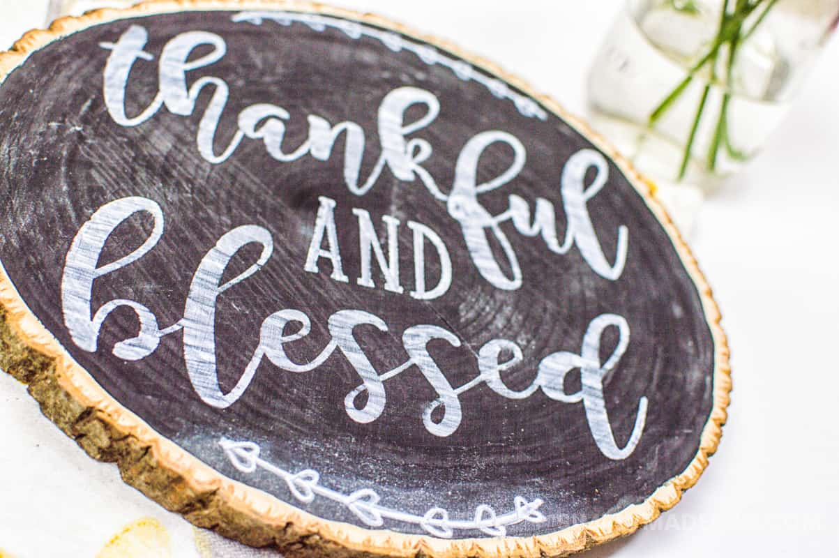 Thankful Chalkboard - I love using stencil vinyl on wood projects to make it look like I used handwritten fonts. This DIY chalkboard is the perfect craft for Thanksgiving and a great reminder for all the things you have to be thankful for this year.