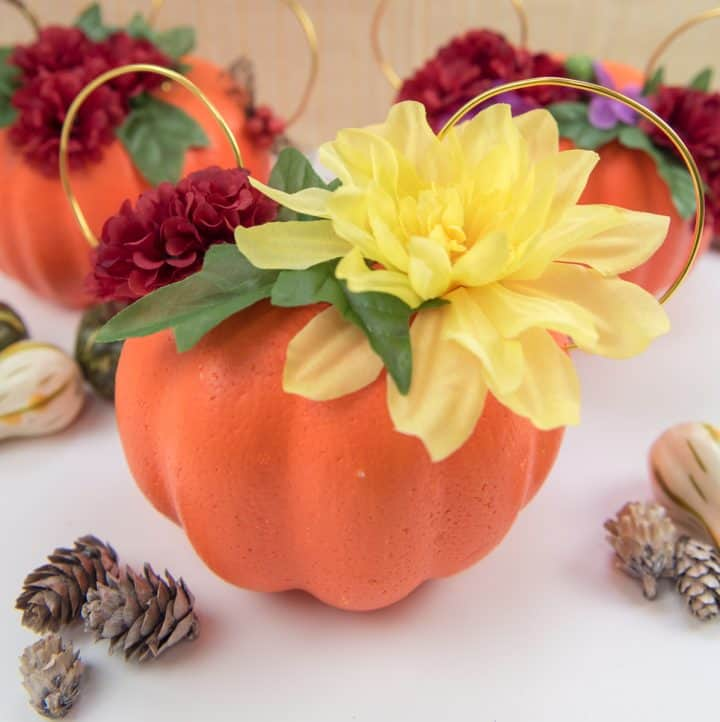 Floral Mickey Ears pumpkin - I hate spending money on pumpkins that mold quickly and make a mess when you carve them. So I'm switching to a simple + cheap version, styrofoam pumpkins from the Dollar Tree, to make my very own Floral Mickey Ears pumpkin!