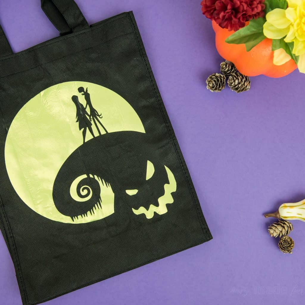 Halloween Tote Bag - As a kid I always wanted my own personalized Halloween tote bag to carry my candy around in, but since that'll never happen I can at least do it for my kids! This easy Nightmare Before Halloween tote bag can be made with a Silhouette or Cricut machine. It's so spooky, even the parents will want one of their own.