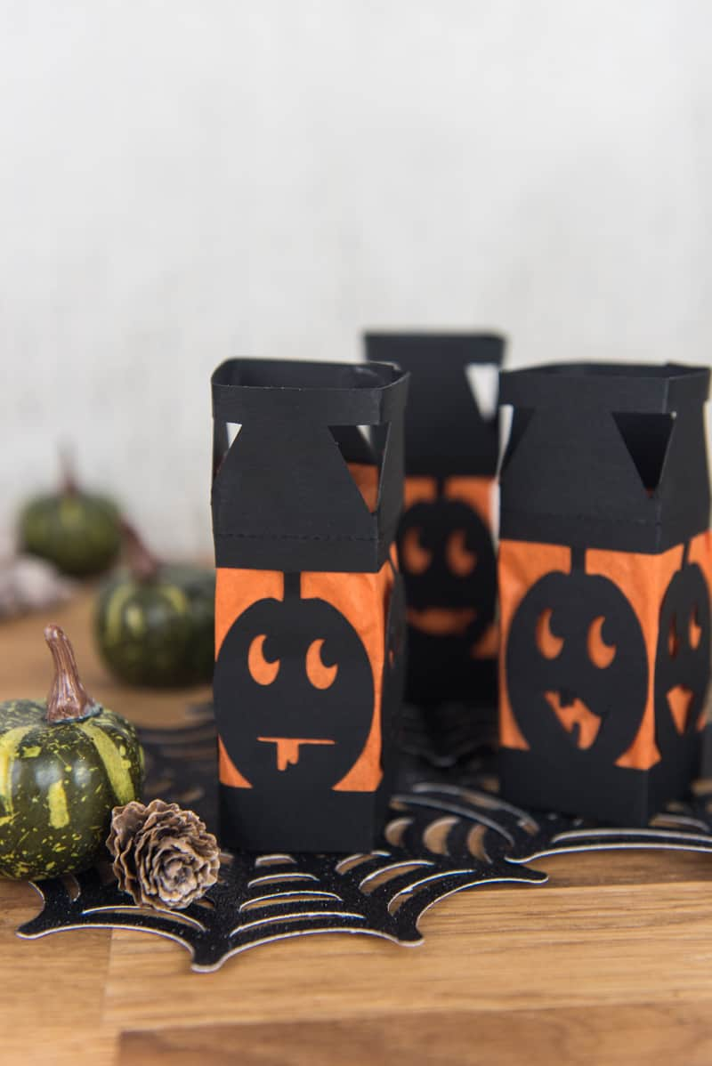 Paper Pumpkin Lanterns - I love lanterns but I hate spending money on them at the store so I decided to make my own mini Halloween paper lanterns instead. They're an easy DIY, cheap, and family friendly. And can be made with a Silhouette or Cricut machine!