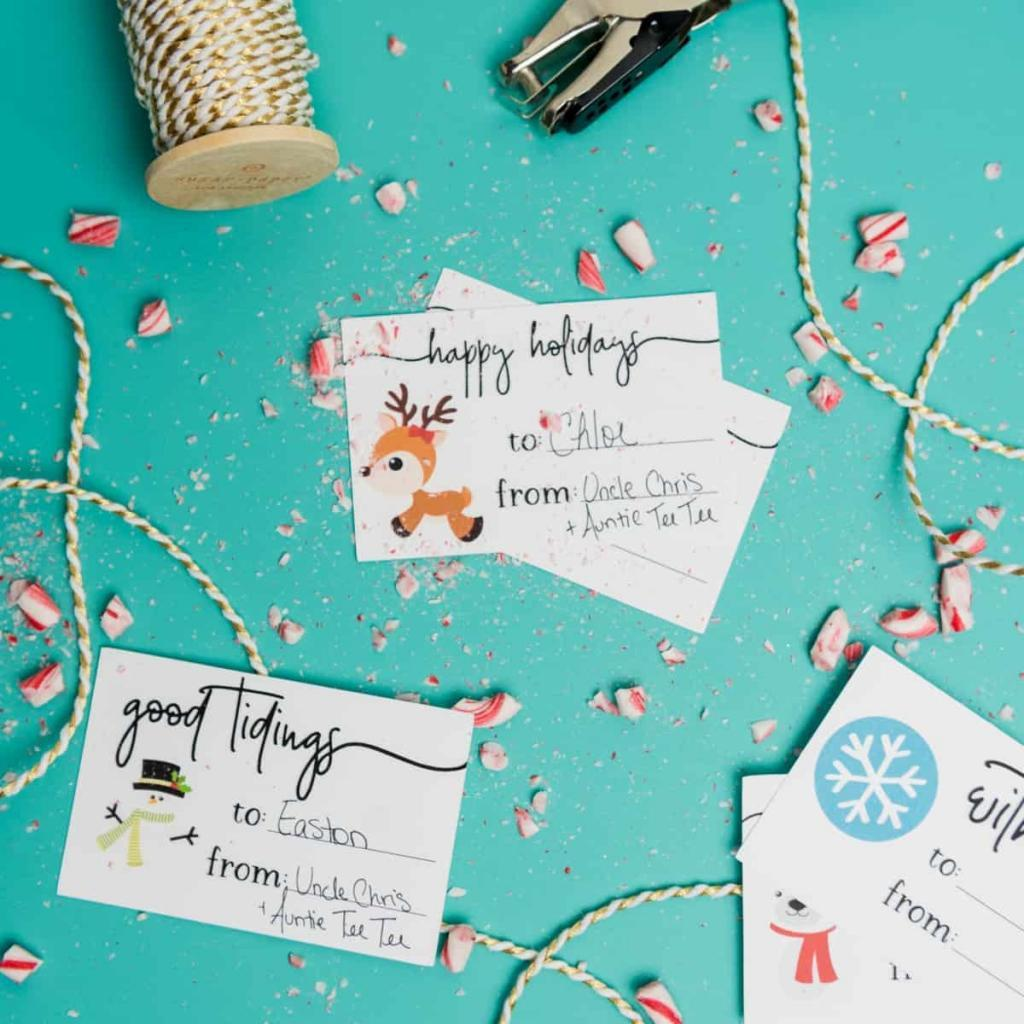 Holiday Gift Tags - The print and cut feature on the Silhouette makes it so easy to DIY personalized gift tags for your holiday parties this year! You can download the PNG + SVG files for both Cricut and Silhouette users and give each of your gifts a little bit of homemade flair this season.