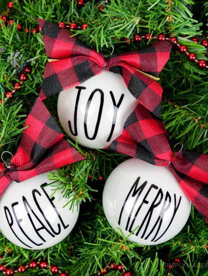 Rae Dunn Inspired Christmas Ornaments - Make yourself a handmade holiday with Rae Dunn inspired Christmas ornaments! Use your Silhouette Machine and permanent vinyl to create a simple rustic look to your Christmas tree this year.