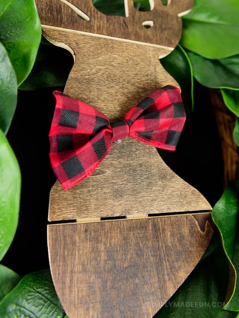 Easiest Holiday Wreath - When Christmas is over my house feels bare without all the decorations, so I grabbed a wooden deer from Hobby Lobby and put it on the wreath that was already on my door. It's a simple + quick DIY that requires 5 supplies (6 if you need a wreath!).