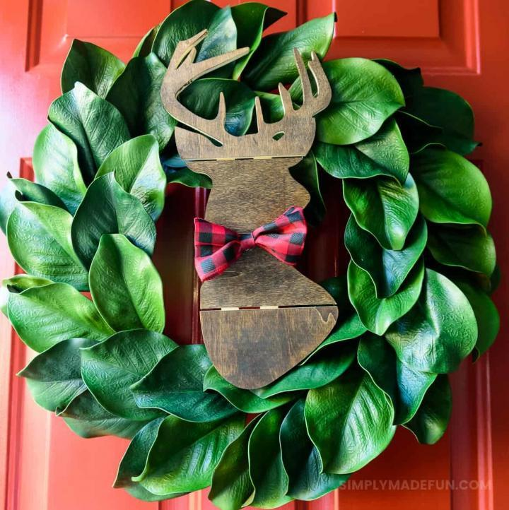 Make the easiest holiday wreath to last through Christmas and beyond! All it takes is a little bit of greenery, wood, and the perfect buffalo plaid ribbon to give your front door a little holiday style.