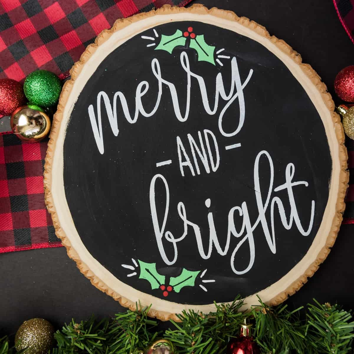 Merry and Bright Christmas Sign - I love saving room and money on Christmas decorations and reversible signs are the perfect way to do both! Using your cutting machine you can repurpose old holiday decor with a new rustic and minimalist design! Free SVG + PNG + DXF file included so you can make one too.