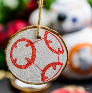 Star Wars Ornaments - Make your own rustic Star Wars Ornaments with wood slices, DecoArt paint, and your Silhouette machine! This simple + quick DIY is perfect for the Star Wars fans in your life!