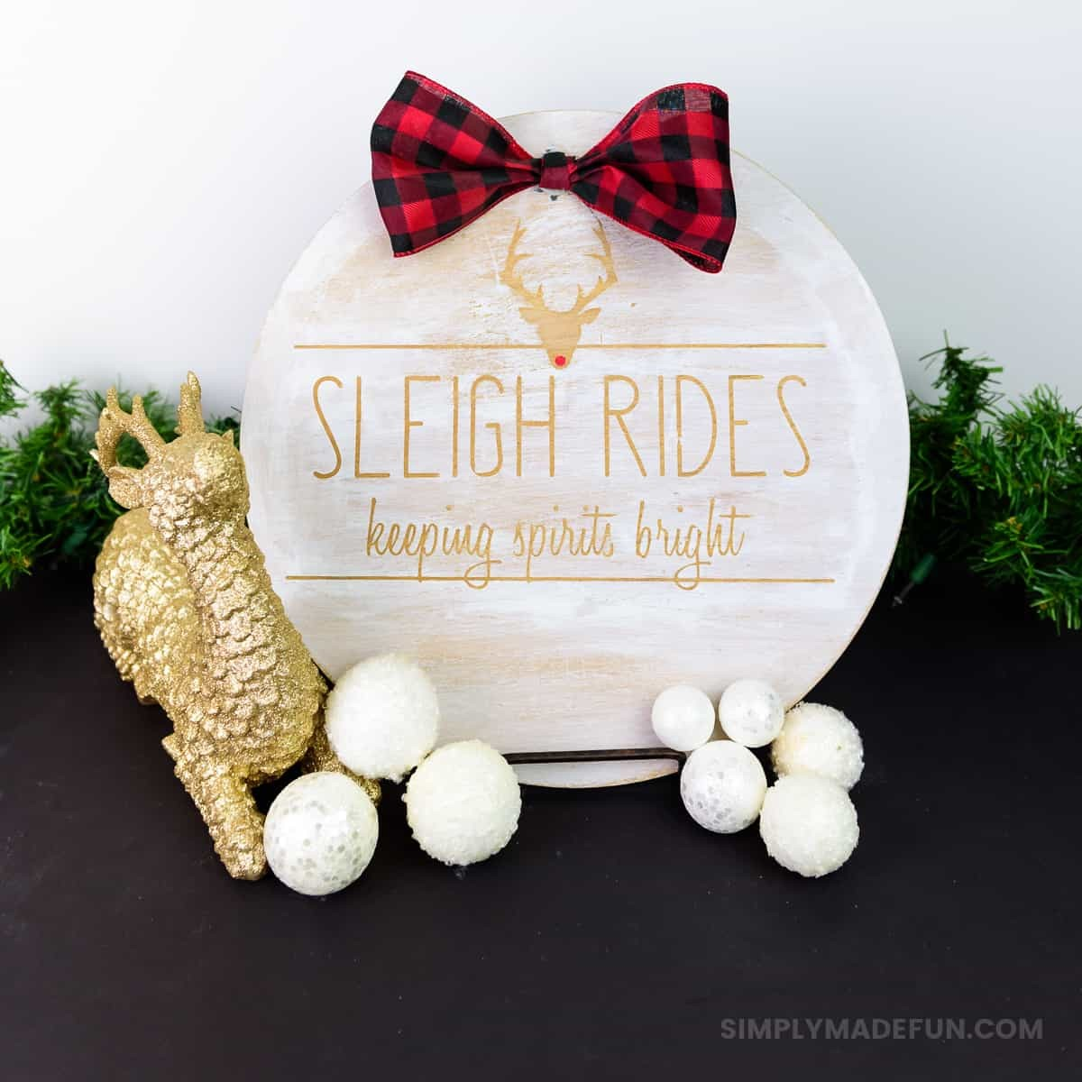 Rae Dunn Inspired Wooden Holiday Sign - After the Christmas decor comes down the whole house feels empty. Make some wall art that'll last all winter long with your Silhouette Machine and some stencil vinyl. This Rae Dunn holiday sign is the perfect rustic DIY for your home!