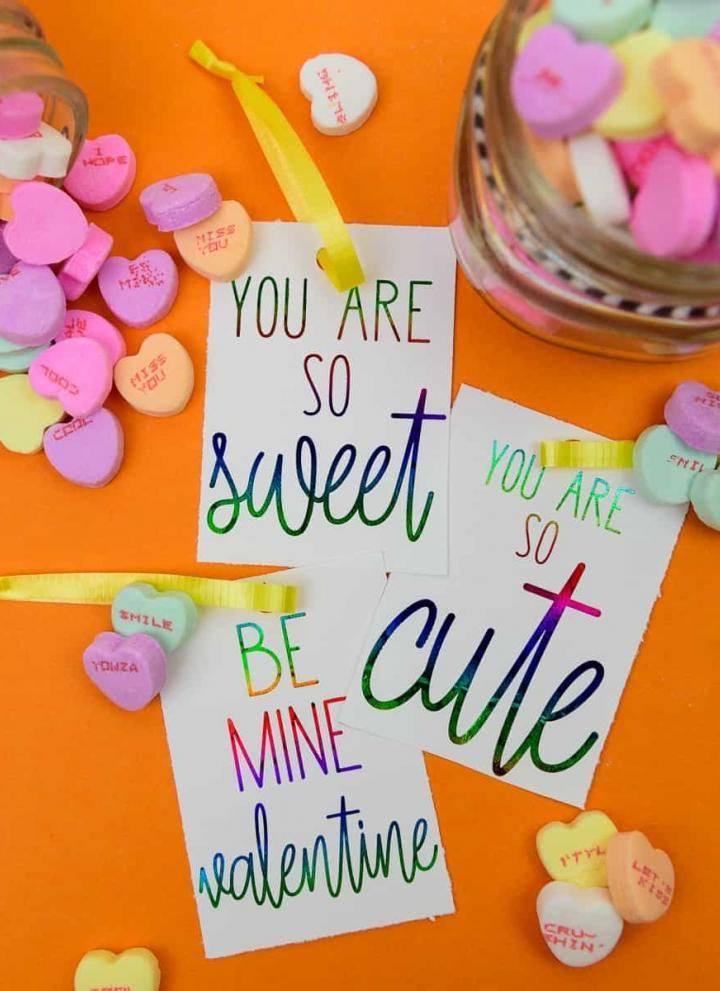 Deco Foil Valentine's Day Tags - I love the look of foil gift tags and never realized how easy it was to do at home! I used my MINC machine and deco foil from Expressions Vinyl to create these candy heart inspired valentines day gift tags!