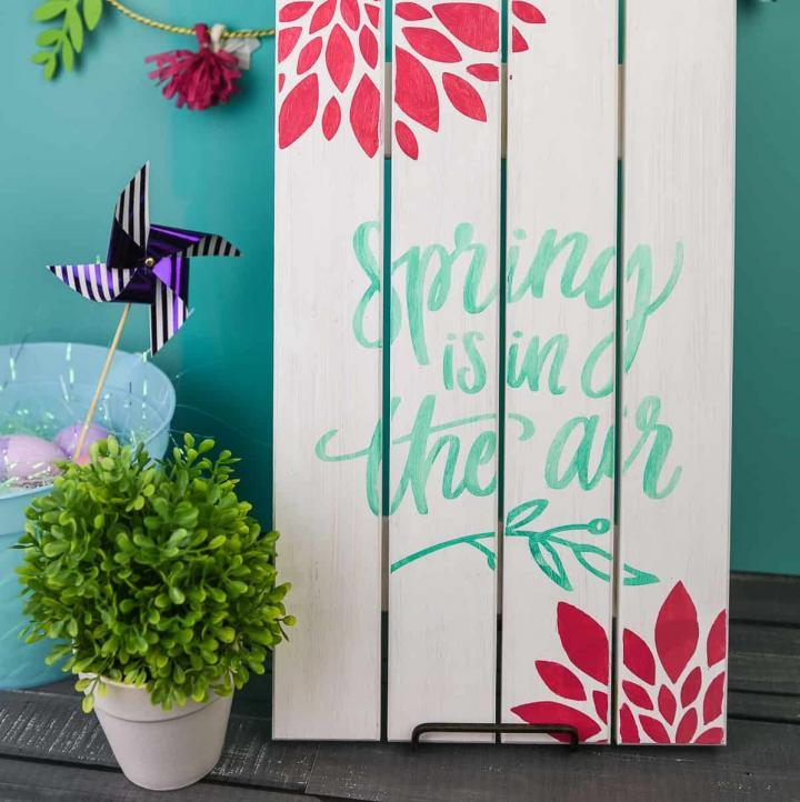 Painted Wooden Spring Sign - Dress up your front porch or your mantle this spring with a bright and colorful wooden sign! Use your Silhouette Cameo to cut out a stencil and pick your favorite paint colors to make this sign your own. It's fun, easy, and you can do it in 20 minutes (or less!).