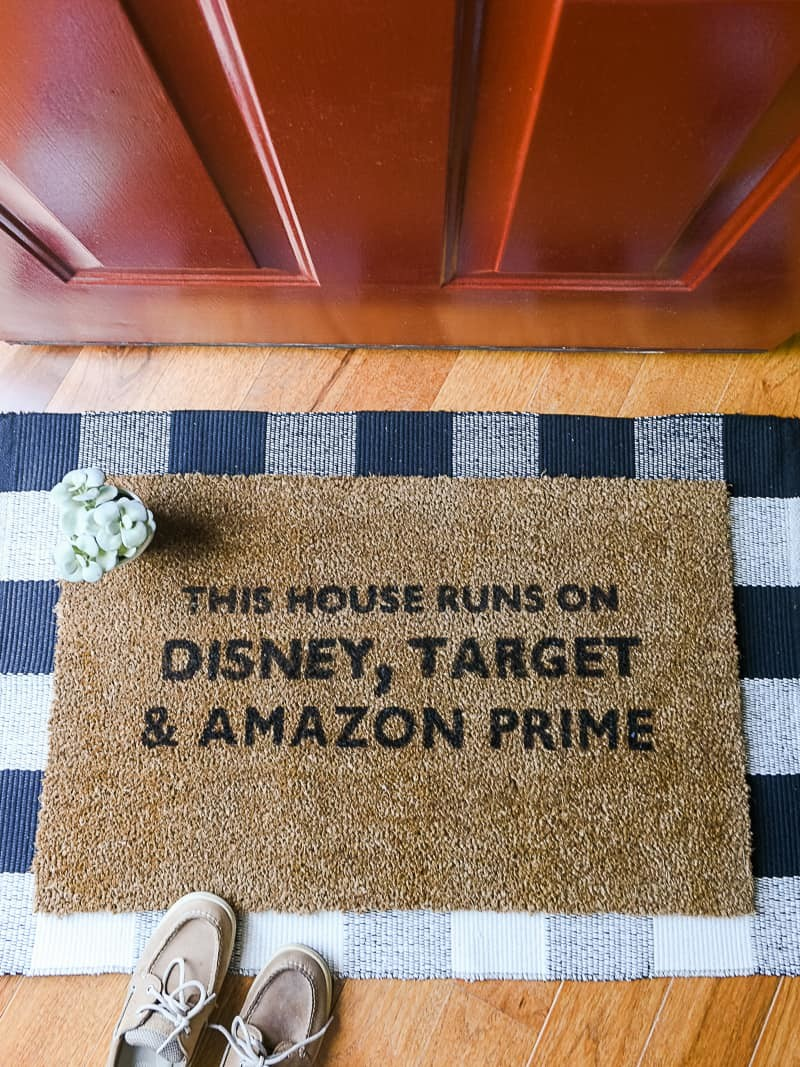 Painted DIY Doormat - I love the funny doormat trend that's taken off lately but wasn't finding one in the store that fit our style, so I decided to make my own. It's SO easy to do and you don't even need a Silhouette Cameo to make it! With just a few supplies you can craft your own DIY doormat that completely fits your personality and looks great on your front porch. But if you're worried about lots of foot traffic or weather causing the mat to fade, DON'T. I've got a few tips to keep your mat looking fresh and new all season long. #diydoormat #coir #coirdoormat