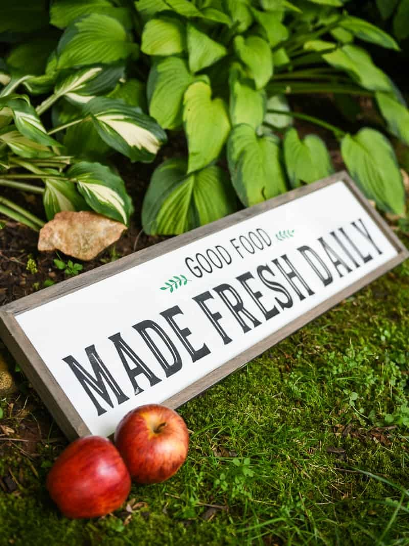Modern Farmhouse Kitchen Sign - Use your Silhouette Cameo to add a little Farmhouse charm to your kitchen with the FREE farmhouse inspired SVG + PNG file! All it takes is 8 supplies (or less!) to make a one of a kind sign to hang up in your home.