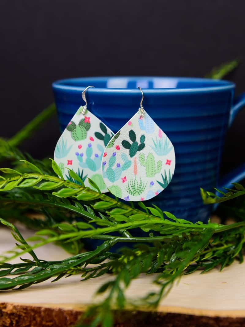 Printed Heat Transfer Vinyl Earrings - It's official, you can use Heat Transfer Vinyl on anything! If you love faux leather earrings because they're lightweight and easy to DIY but are tired of them being plain, you can easily dress them up with heat transfer vinyl and an iron! They take less than 20 minutes to make and the pattern choices are endless.