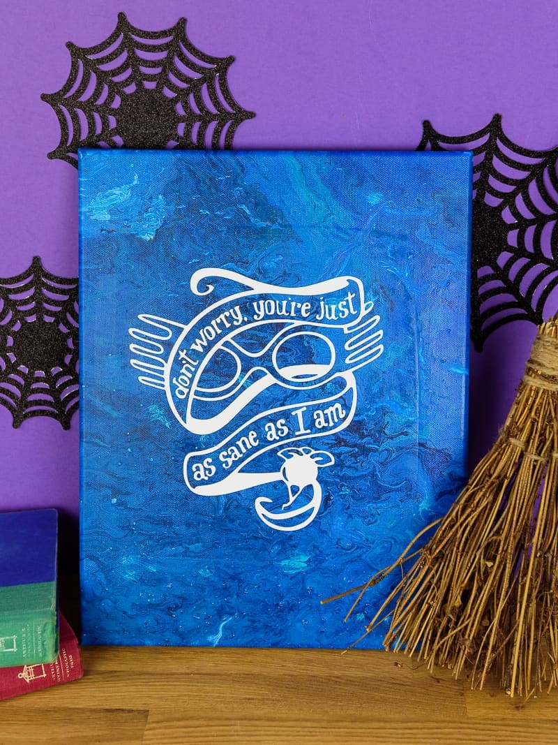 Harry Potter Acrylic Paint Poured Canvas - This poured canvas is the perfect craft night project to DIY with friends! It's fun, messy, and no two canvases will be alike! You can leave them blank or use vinyl and your Silhouette or Cricut machine to dress them up a bit, like with a fun Harry Potter inspired quote or image...or really anything that you like. This craft project is colorful and easy, all you do is mix paint with water and pour!