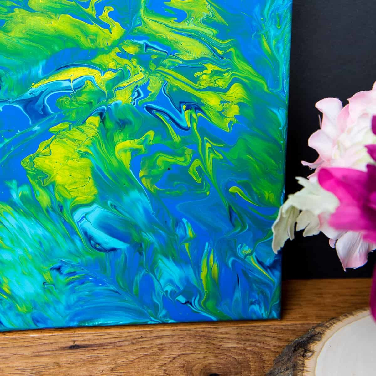 Acrylic Pour Canvas - This is one messy DIY but it is really fun to make too! You can get creative with color and design and no two art projects will be the same! It's the perfect art piece for your home that YOU made all on your own!