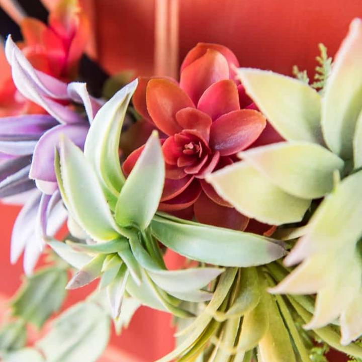 Use fake plants to make a faux succulent wreath for your front door!