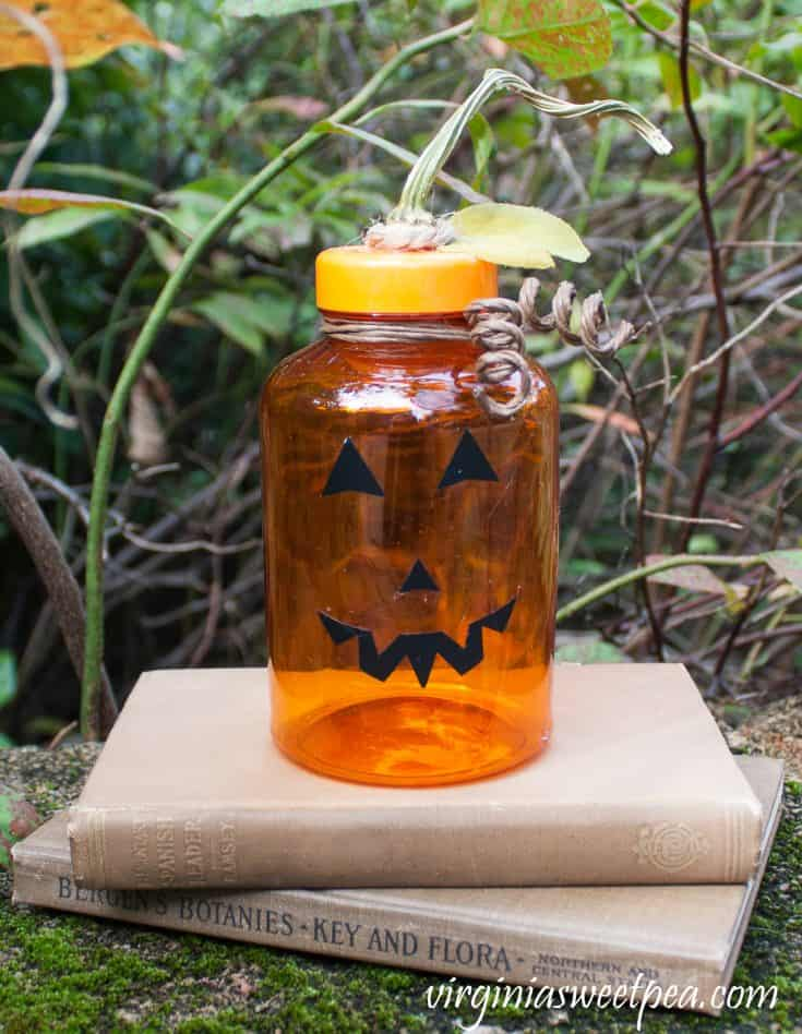 Upcycle a medicine bottle to make a Jack-o-Lantern.
