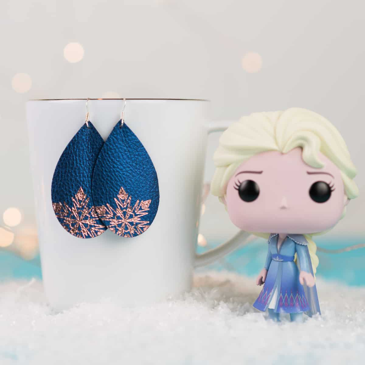 Elsa-inspired-faux-leather-earrings-with-foil-quill-pens-SM
